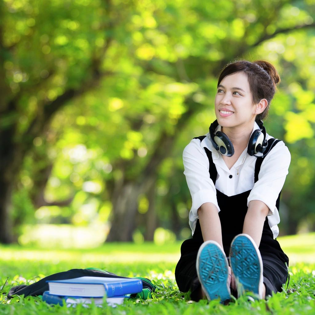 Student sitting in scenic campus